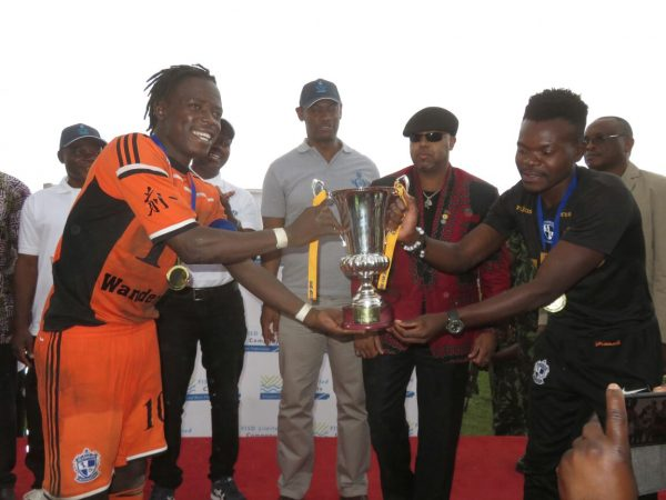 Nomads stand in captain Kamwendo, injured Captain Francis Mlimbika hold the cup as Chilima looks on, Pic Alex Mwazalumo