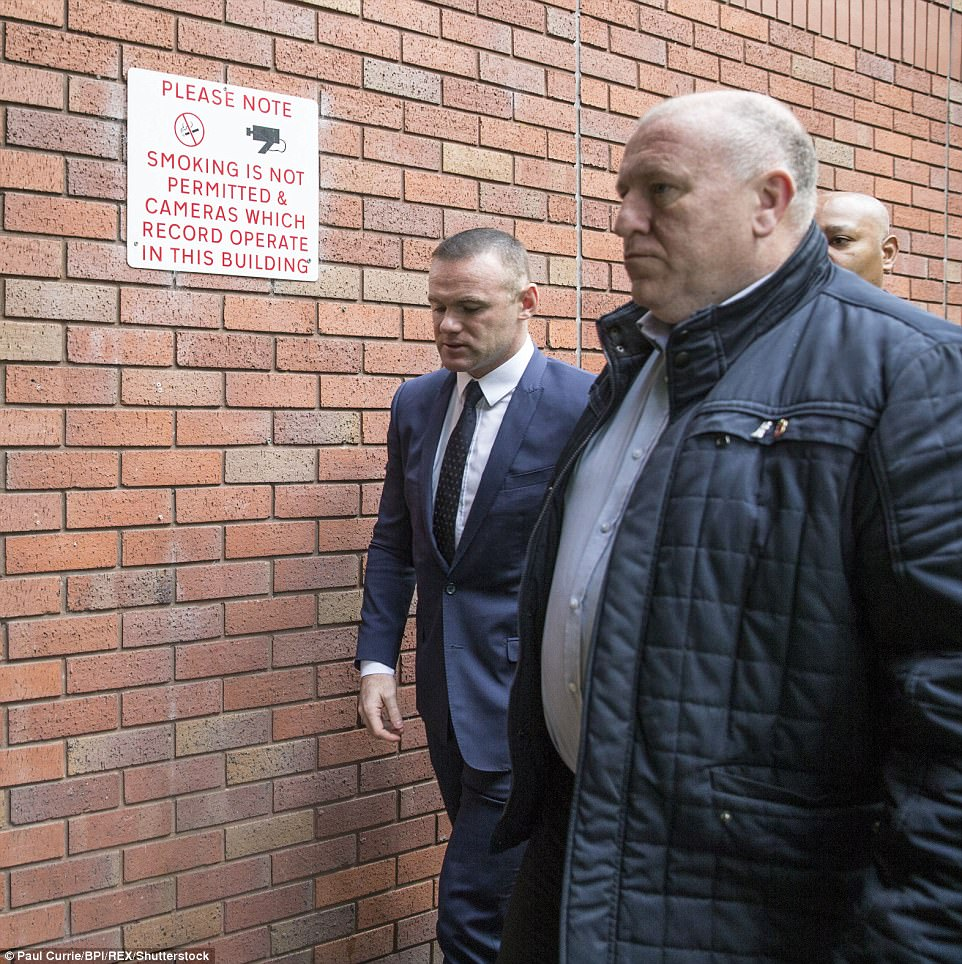 Rooney arrived at court along with his agent Paul Stretford and flanked by two burly security guards