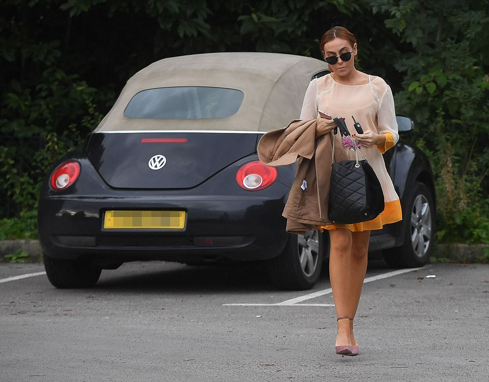 Laura Simpson, 29, pictured on her way to work this morning after parking her Volkswagen Beetle that Rooney was caught driving