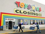 Shoppers push their carts toward a Toys 'R' Us store entrance in Arlington Heights, Illinois in January 2006. The company has filed for bankruptcy protection