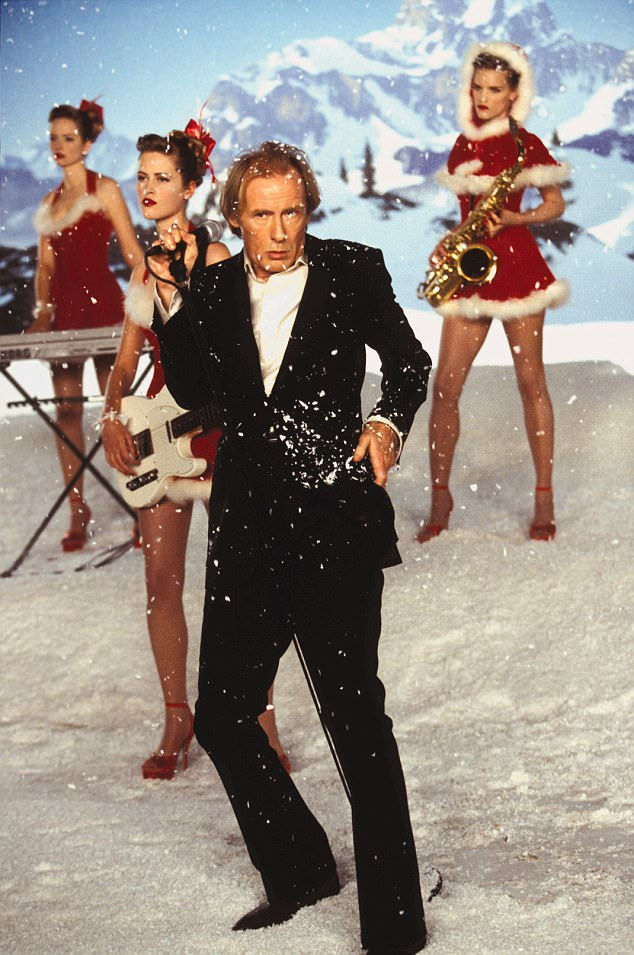Flamboyant:The film also includes songs such as Bill Nighy's Christmas Is All Around (above), All You Need Is Love by the Beatles and Too Lost in You by the Sugababes