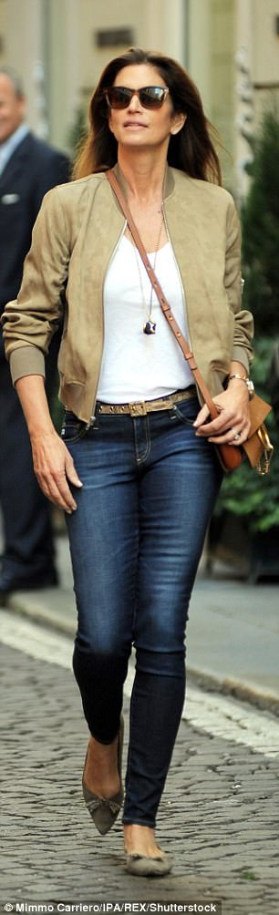 Street style: Complementing her daughter's cool threads, Cindy, 51, worked a pair of skintight dark wash denims which accentuated her lean limbs