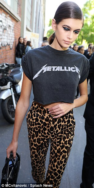 Rock on:Keeping to her unique style, she teamed the look with a cropped T-shirt with rock band Metallica emblazoned across the front