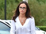 Stacey Flounders has been pictured at her new job days after it emerged the former model is 'struggling' since her splits from peadophile ex-footballer Adam Johnson