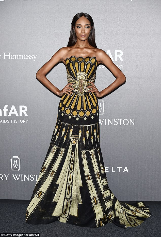 S-Dunn-ing:The Vogue covergirl, 27, looked incredible in the bandeau maxi dress, which flared out just below her bust in order to accentuate her tiny waist and famously long legs