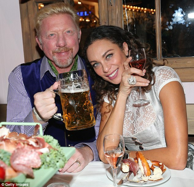 Cheers! Boris Becker and wife Lilly indulged with classic Oktoberfest fare and drinks aplenty at Munich, Germany's Theresienwiese on Monday
