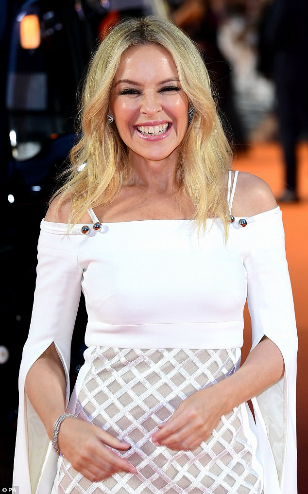 Effervescent:The youthful star wore her blonde locks in soft waves and parted in the middle while her sparkling peepers were enhanced with fluttery lashes and liner