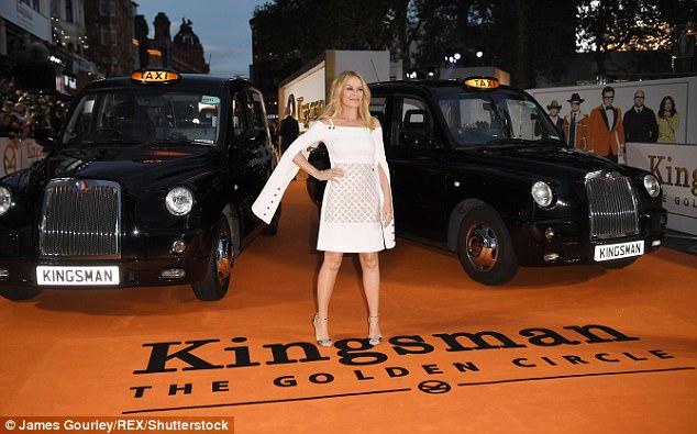 Making waves: Kylie popped in her white dress as she posed with two black cabs