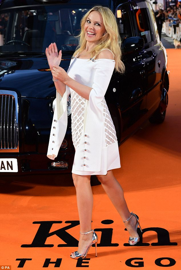 Got her seal of approval: Kylie was seen clapping away as she posed for snappers