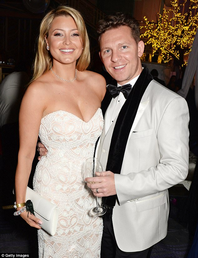 Family unit: The former Neighbours star, 34, already raises three-year-old son Luka with her property tycoon husband, Nick Candy