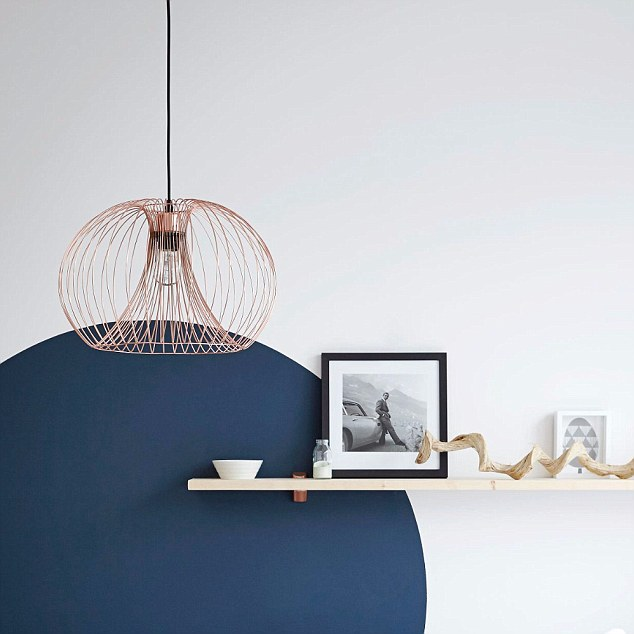 Use modern, statement pieces around your home to accessorize this look - like thisJonas Wire Copper Pendant ceiling light, £47 from B&Q