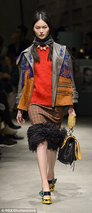 Autumn awesomeness: Coach¿s creative director Stuart Vevers rocked a folksy vibe at his catwalk show, incorporating shearling and fur coats embroidered blazoned with horses (left) while Prada did a new take on tartan patterns (right)