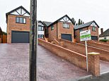Parking problems: Neighbours have branded a home in Walsall, West Midlands, as 'ridiculous' - after it was built with a telegraph pole right in front of the driveway