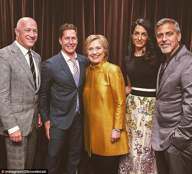 George Clooney (right) is pictured in a recent photo with Hillary Clinton on Instagram. He spoke in a wide-ranging interview with the Daily Beast where he admitted Clinton was 'qualified' to be president, but wasn't a 'skilled communicator'