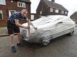 Neil Junglas from Hunts Cross, Liverpool, wrapped a car in cling film after becoming frustrated with people parking outside his house and then going on holiday