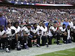 Baltimore Ravens players, including former star Ray Lewis (second right) kneel during the playing of the national anthem