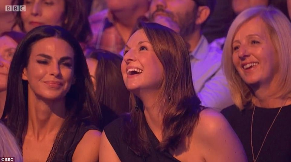 Good sport: Davood's wife Isobel flashed a good-natured grin after Claudia mentioned her