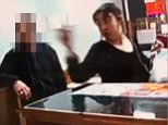 CCTV shows the woman unashamedly launching the racist tirade at workers