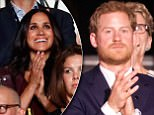 Meghan Markle (center, wearing dark red), girlfriend of Britain's Prince Harry, applauds during the opening ceremony for the Invictus Games in Toronto, Canada, September 23, 2017.