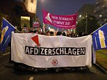 Protesters took to the streets of Berlin angry that the far-right AfD won 13.5 per cent support during Germany's election, meaning they will get seats in parliament for the first time (pictured, a banner that reads 'Smash the AfD')