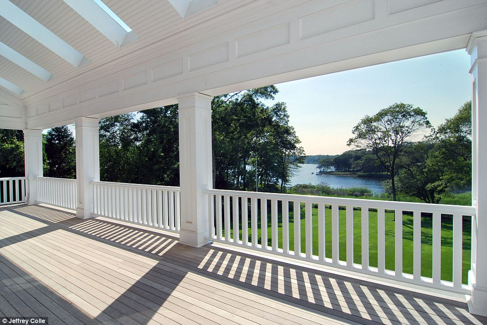 The wrap around porch offers 360-degree views of the two-acre property, pond and preserve