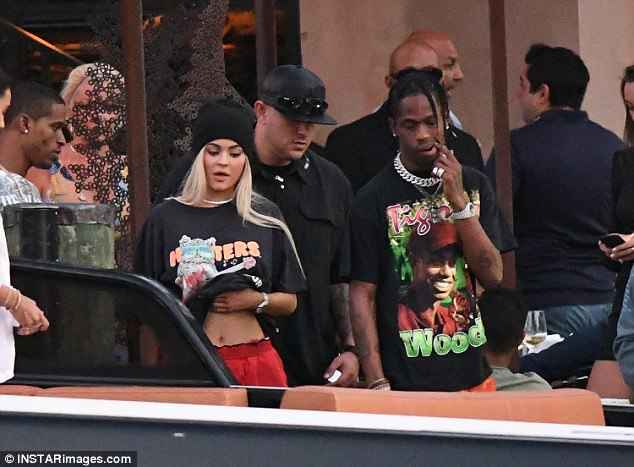 Close:Her younger sister, Kylie, is rumored to be expecting her first child; pictured with her boyfriend Travis Scott in May in Miami