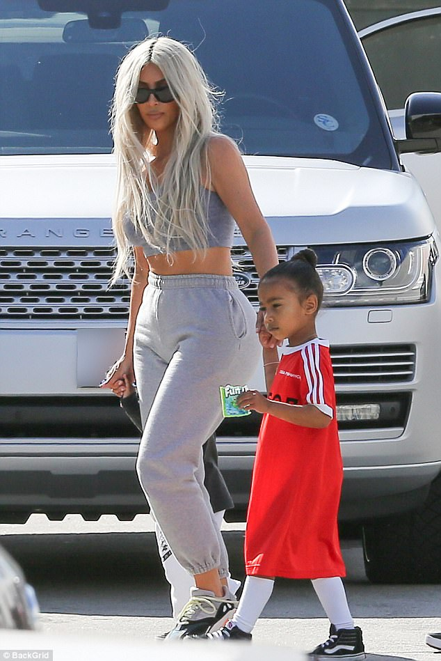 So gorgeous:The 36-year-old entrepreneur flashed her flat stomach in grey sweat bottoms with a coordinating crop top
