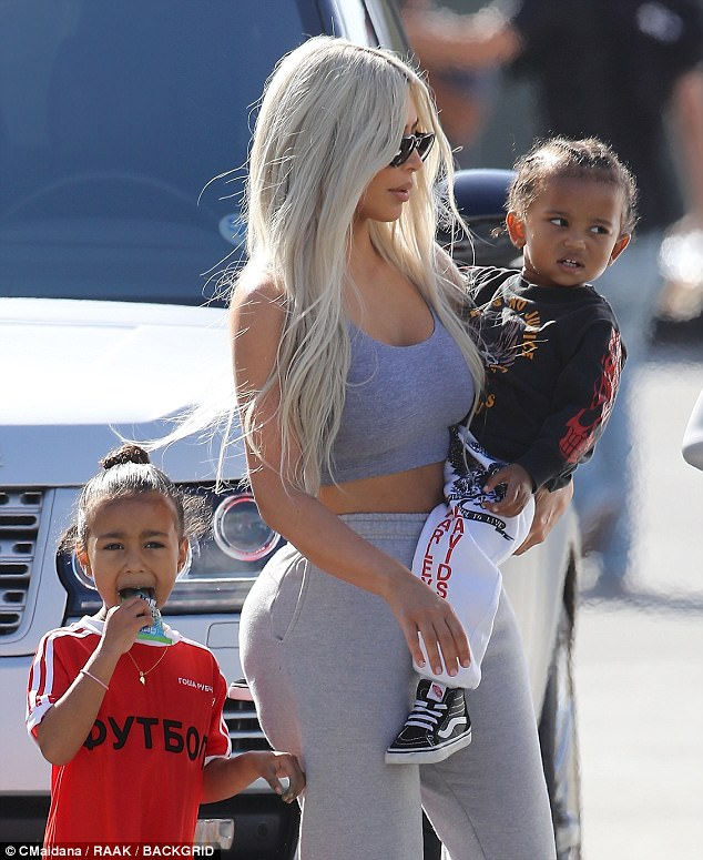 The pretty businesswoman carried son Saint in her arms while North stayed close