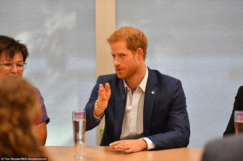 Prince Harry kicked off a busy day meeting youngsters being treated at the Centre for Addiction and Mental Health in Toronto, Canada's largest mental health and addiction hospital as well as workers (pictured)