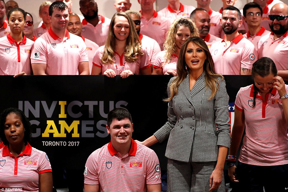 Melania Trump rests her hand on a member of Team USA's back ahead of the opening ceremony of Prince Harry's Invictus Games