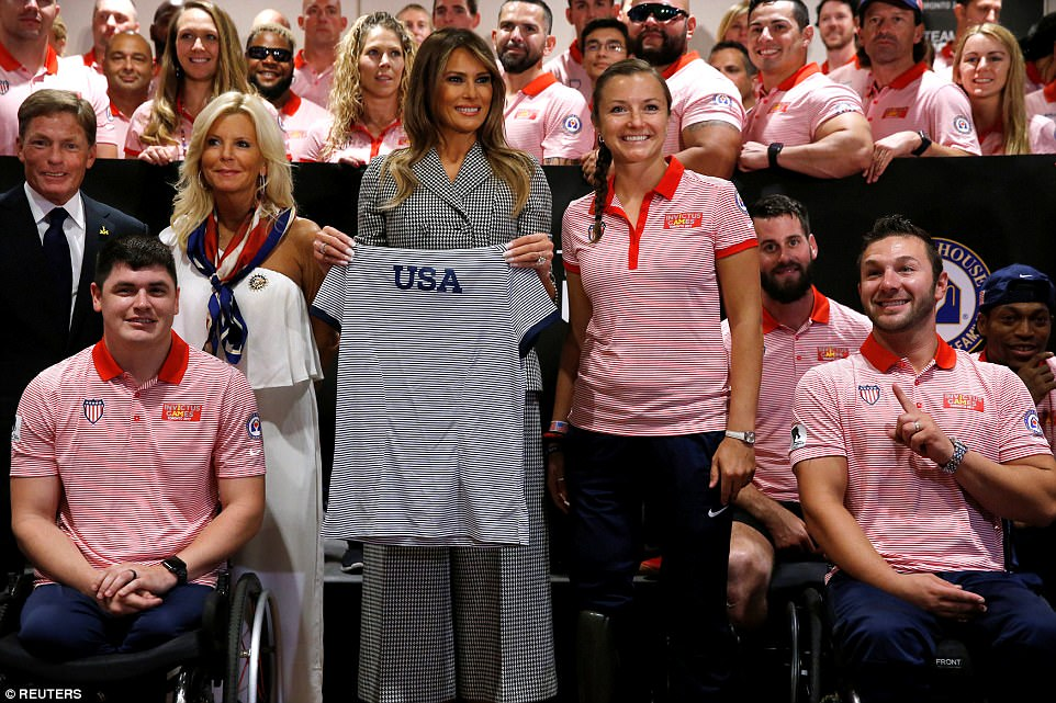 Supporting the cause: Melania greets members of Team USA prior to the opening ceremony of the games; Michelle Obama championed the games the first two years and this was Melania's first time meeting the group