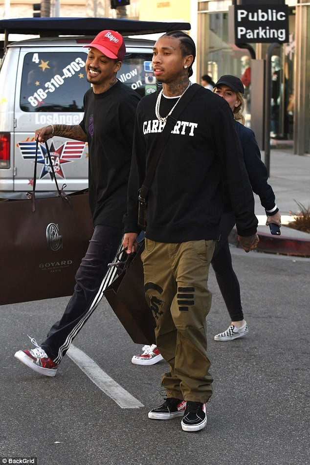 Casual: Tyga- real name Micheal Ray Stevenson- stepped out wearing a black sweatshirt with the word 'carhartt' and baggy olive green pants