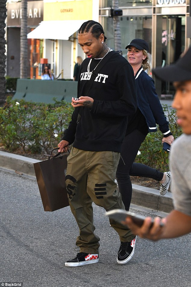 Fresh to death: The rapper paired red and black Luis Vuitton shoes with his ensemble
