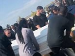 Celebrity mourner: Drake (center) is seen acting as one of the pallbearers at the funeral of his slain friend Anthony 'Fif' Soarer in Pickering, Ontario, on Saturday