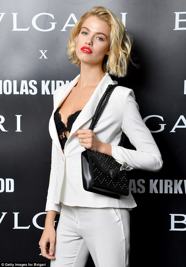 Working it: Hailey flaunted her cleavage in a black lace bustier paired with a white pant suit during Milan Fashion Week's events on Wednesday