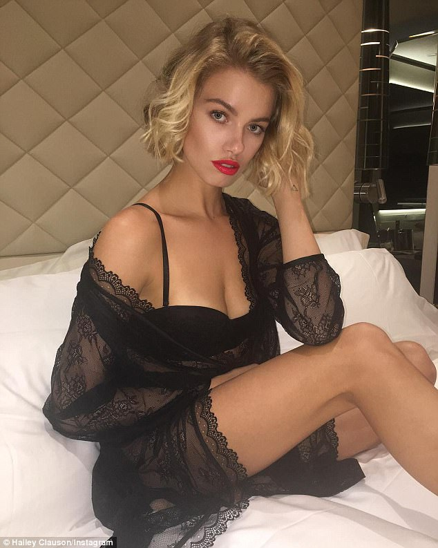 'Sweet dreams':Hailey posted a sultry snap to her Instagram later on Wednesday. She's pictured sitting on a bed in a black bra and a sheer black wrap