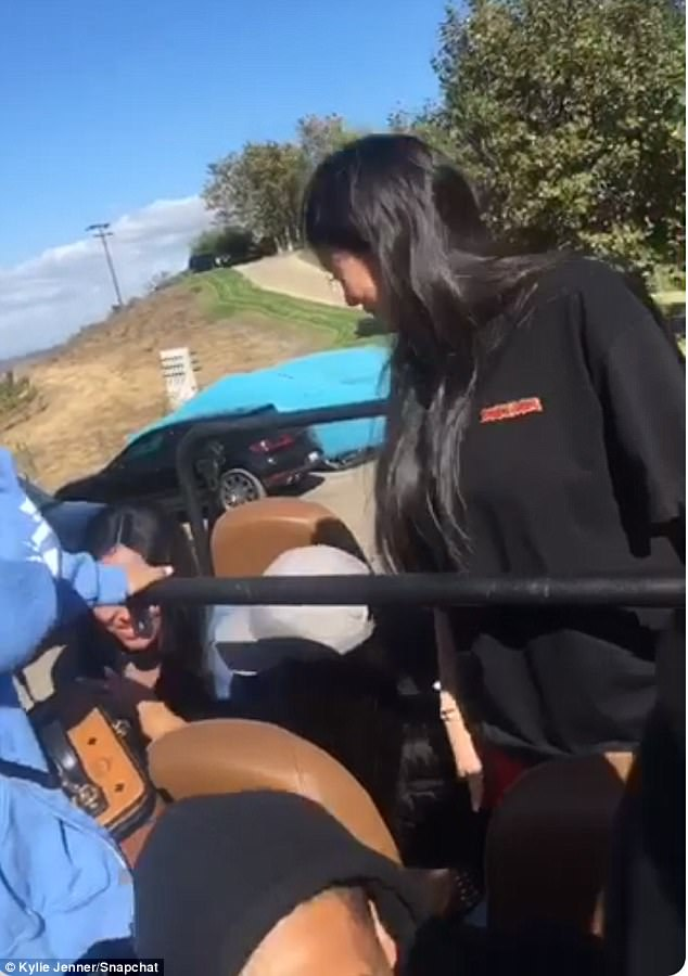 Good times: Kylie pictured on the right during the safari ride