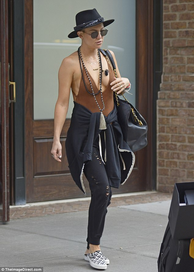 Hip hippie! Kate Hudson oozed boho chic Saturday in NYC, going bra-free in a plunging brown top adorned with layers of beads, bangles, and a black fedora as she checked out of her Greenwich Hotel