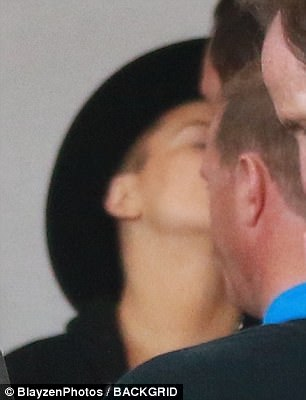 The look of love!At JFK, the How TO Lose A Guy In Ten Days actress couldn't help but beam and plant a smooch on her boyfriend's face