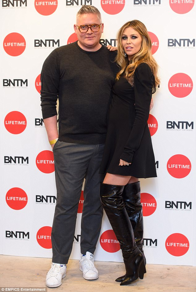 Leggy: Abbey struck a smouldering pose as she posed up with fashion icon Giles