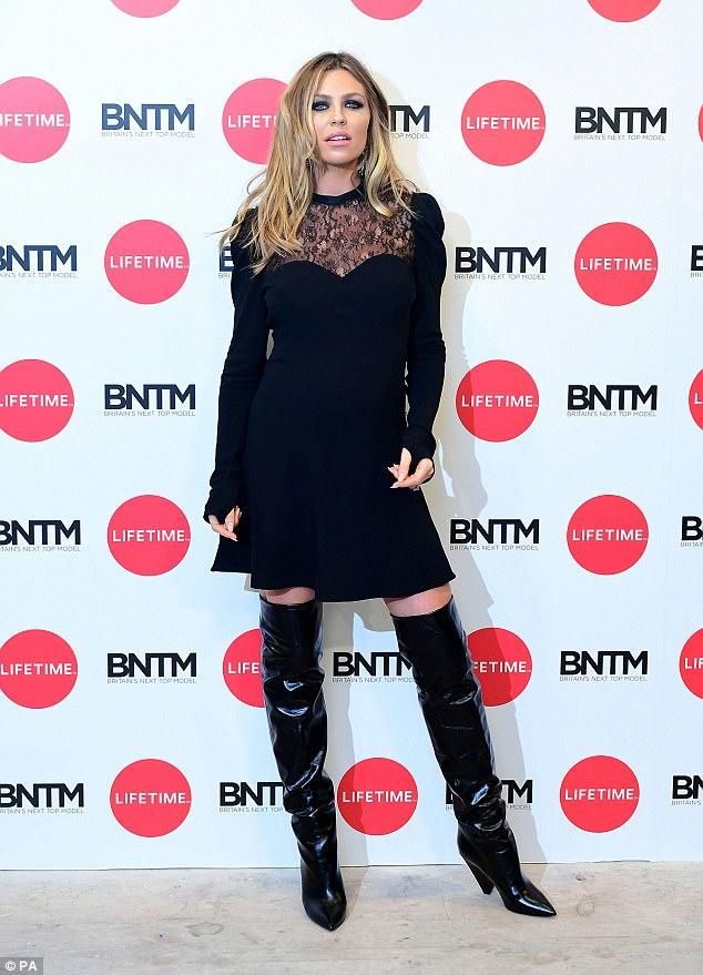 Stunning: The 31-year-old model looked incredible as she paired the dress with some sultry thigh high black patent boots, which flaunted her endless legs