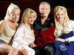 LOS ANGELES - JUNE 18:  Hugh Hefner poses with Kendra Wilkinson (L) Bridget Marquardt and Holly Madison (R)  before a screening of Bonnie and Clyde at the Playboy Mansion June 18, 2004 in Los Angeles, California.  (Photo by Carlo Allegri/Getty Images)