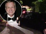 Hugh Hefner's body was driven away from his Playboy mansion early Thursday morning to begin the journey to his final resting place next to Marilyn Monroe. Pictured is his casket inside the hearse