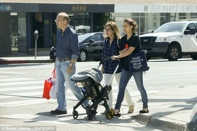 Doting mom: The actress sported a casual ensemble with a black T-shirt and jeans