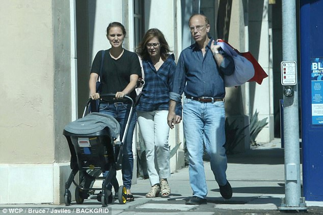 Relaxing: The actress, 36, was seen pushing baby Amelia in a stroller while taking a relaxing walk in the warm California sun