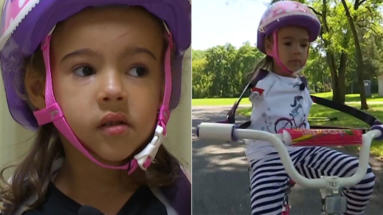 Five-year-old born without arms learns to ride a bike