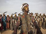 Stunning photos have emerged showing tribesmen celebrating as they take part in a traditional courtship competition in Niger