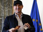 Ralph Fiennes has received a Serbian passport from the Balkan country's president after he was granted citizenship in thanks for filming his second film in the country