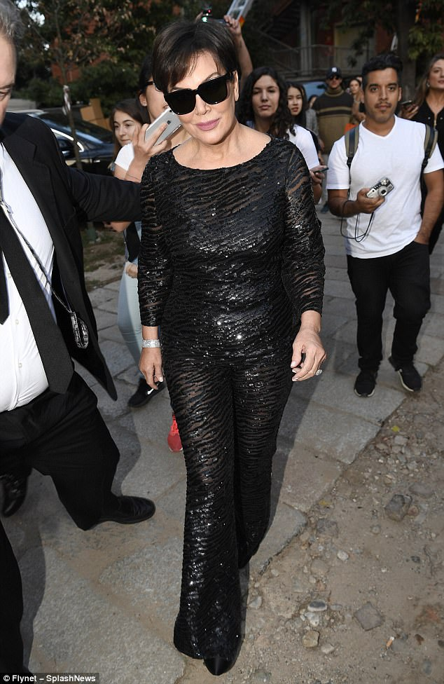 Getting her sparkle on...The matriarch of the Kardashian clan stepped out in a long black sequinned jumpsuit with sheer patterned paneling