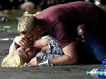 Matthew Cobos was photographed on Sunday night lying on top of a young woman in an attempt to shield her from the barrage of bullets tearing through the air around them